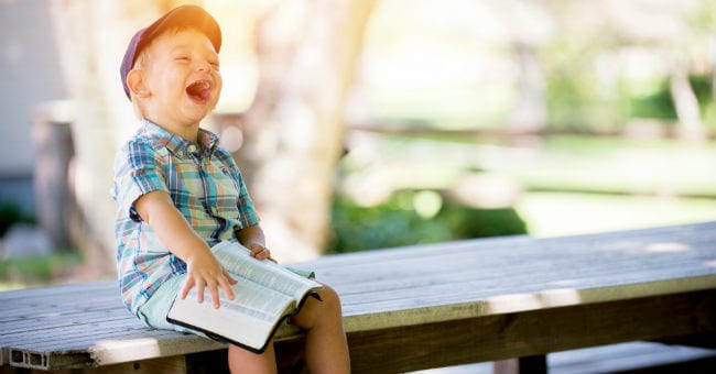 boy-bible-laughing